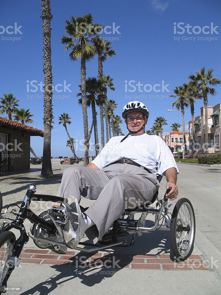 senior man biking royalty-free stock photo
