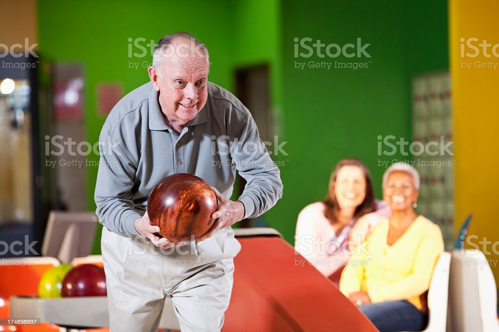 Senior man bowling royalty-free stock photo