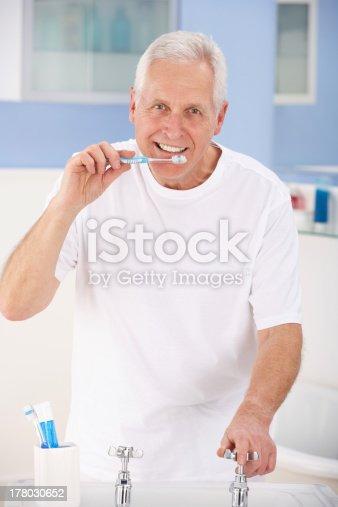 istock Senior man brushing teeth 178030652