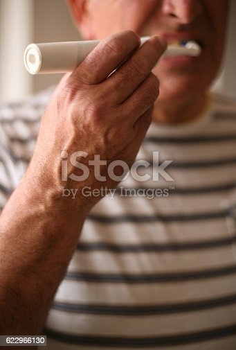 istock Senior man brushing teeth. 622966130