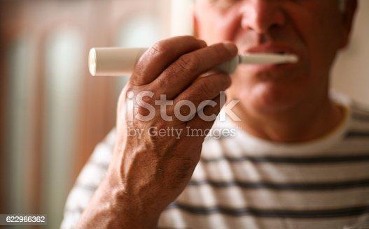 istock Senior man brushing teeth. 622966362