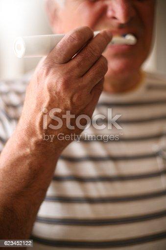 istock Senior man brushing teeth. 623452122