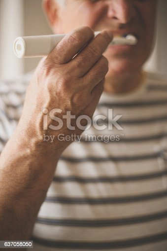 istock Senior man brushing teeth. 637058050