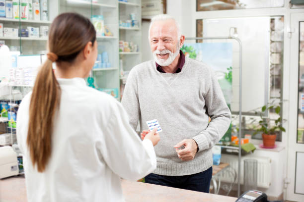 Senior man buying medications at a drugstore stock photo
