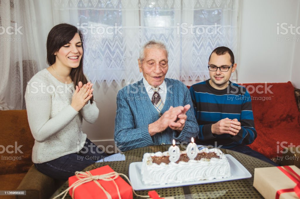Senior man is celebrating birthday with his family