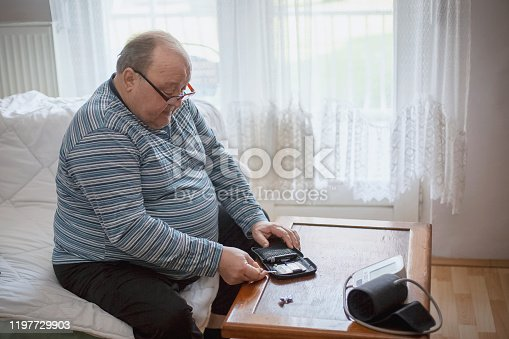 Senior man checking blood sugar levels