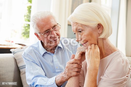 874789476istockphoto Senior Man Comforting Woman With Depression At Home 874788502