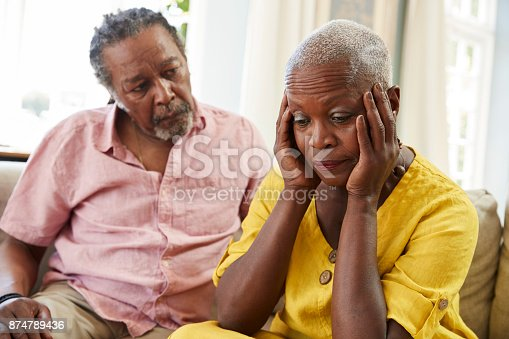 874789476istockphoto Senior Man Comforting Woman With Depression At Home 874789436