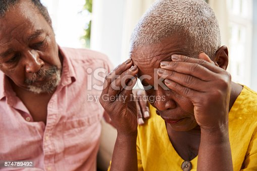 874789476istockphoto Senior Man Comforting Woman With Depression At Home 874789492