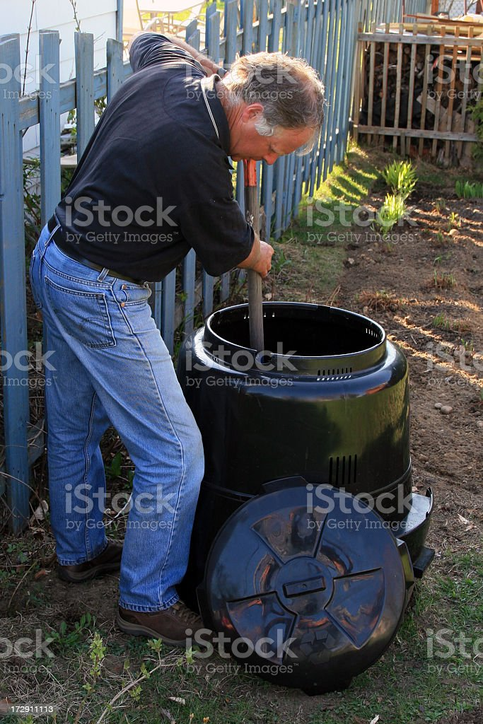 Senior Man Composting and Gardening at Home royalty-free stock photo