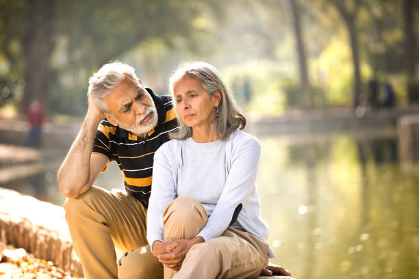 Senior man consoling his angry wife stock photo