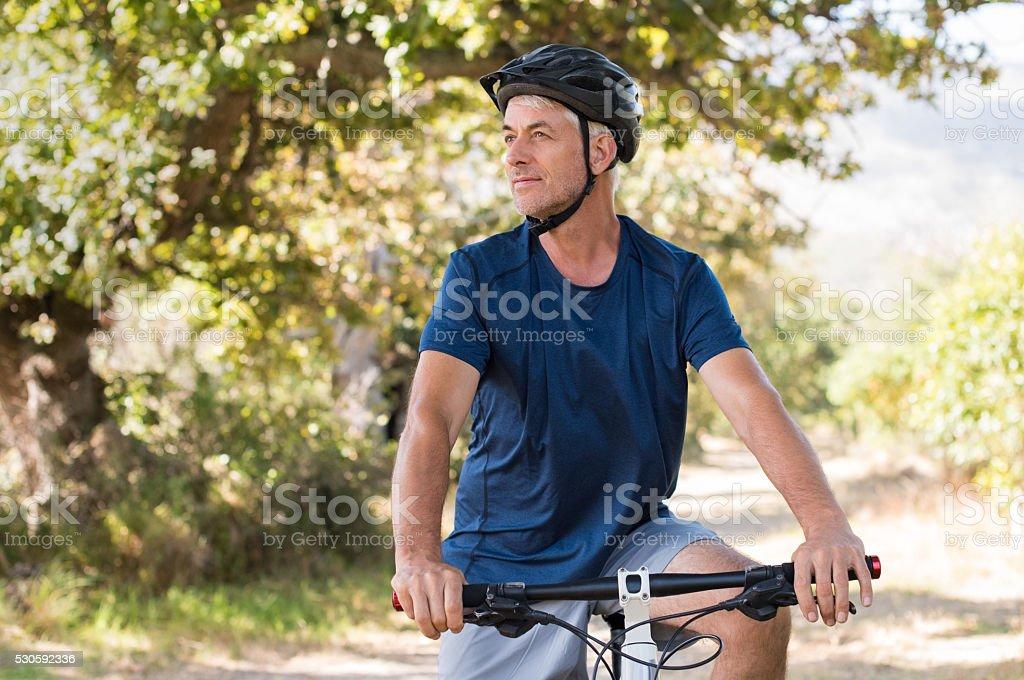 Senior man cycling stock photo