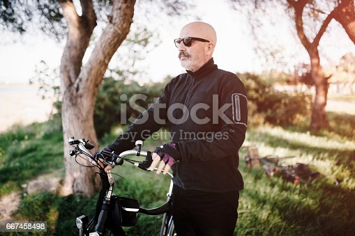 518659854istockphoto Senior Man Cycling 667458498