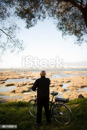 istock Senior Man Cycling 667458614