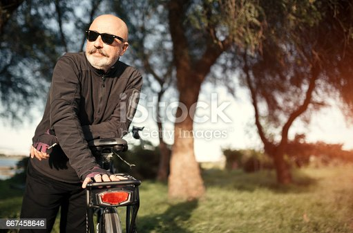 518659854istockphoto Senior Man Cycling 667458646