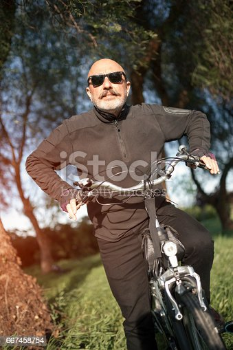 518659854istockphoto Senior Man Cycling 667458754