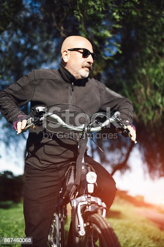 518659854istockphoto Senior Man Cycling 667460068