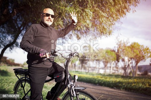 518659854istockphoto Senior Man Cycling 667460878