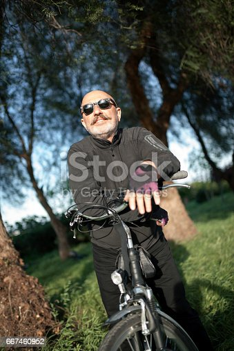 518659854istockphoto Senior Man Cycling 667460952
