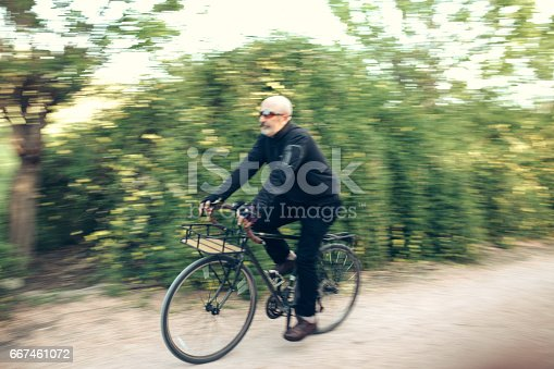 518659854istockphoto Senior Man Cycling 667461072