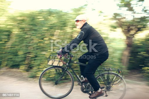 518659854istockphoto Senior Man Cycling 667461114