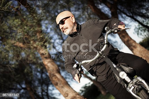 518659854istockphoto Senior Man Cycling 667461142