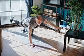 istock Senior man doing balance exercise 1239568544