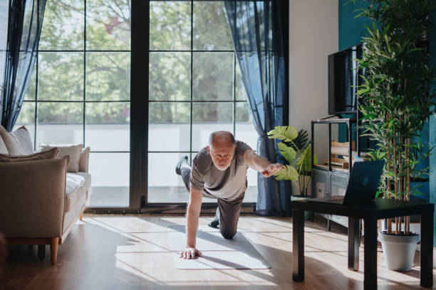 Senior man doing balance exercise stock photo