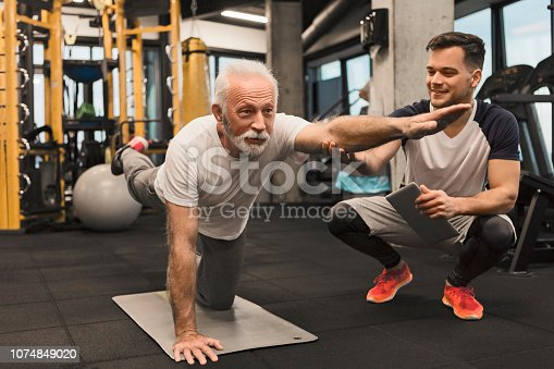 Senior man doing balance exercise