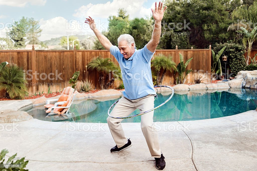 Senior man doing hula hoop stock photo
