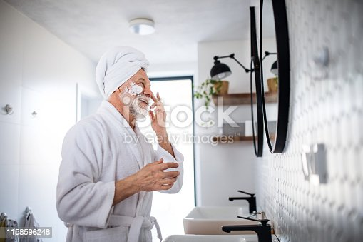 istock A senior man doing morning routine in bathroom indoors at home. Copy space. 1158596248