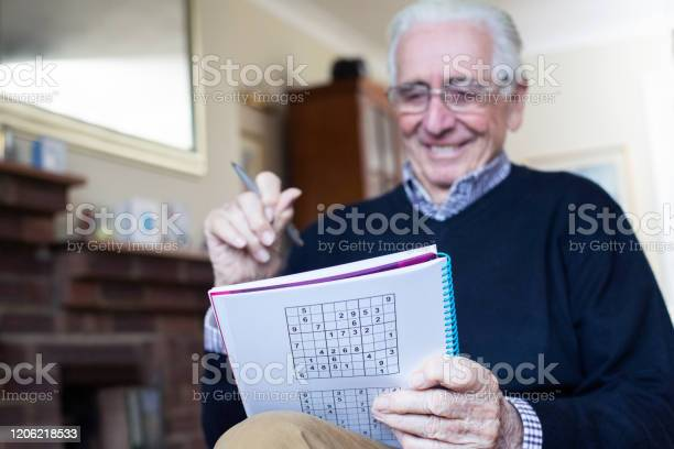 Senior man doing sudoku puzzle at home picture id1206218533?b=1&k=6&m=1206218533&s=612x612&h=od7 nao s5s56c8jqhauulvomwxw6kw3xwmbc 3mxne=