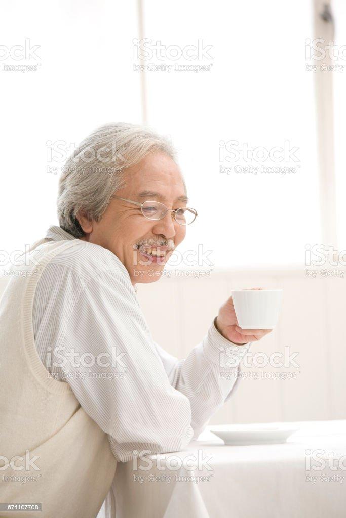 Senior man drinking coffee royalty-free stock photo