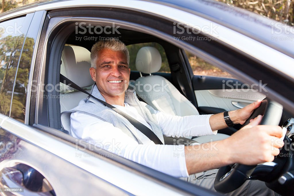 senior man driving his new car stock photo