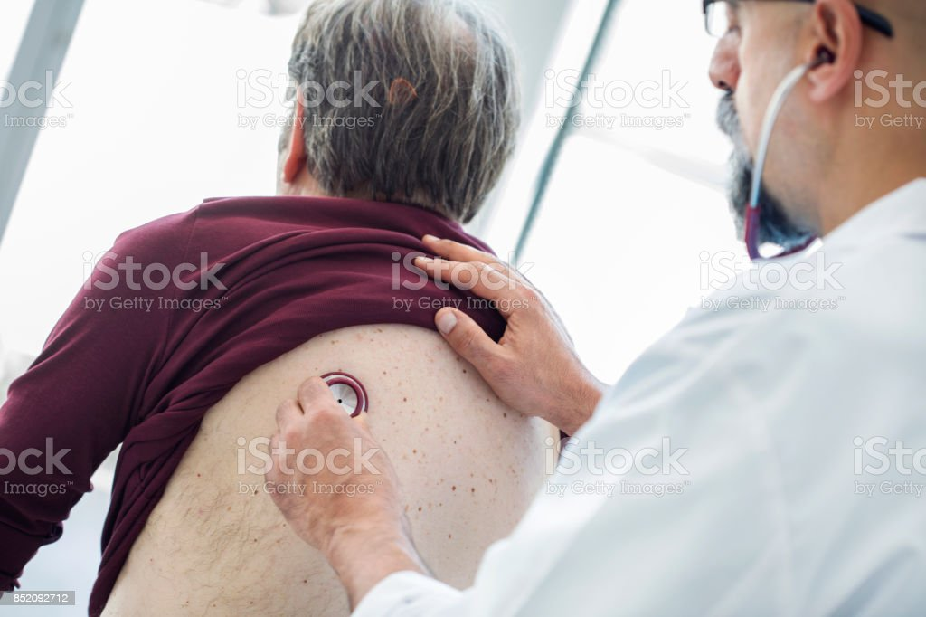 Senior man during medical examination stock photo