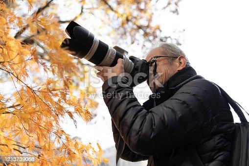 Senior man enjoying autumn