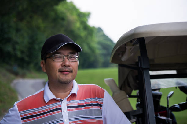 Senior man enjoys his round of golf stock photo