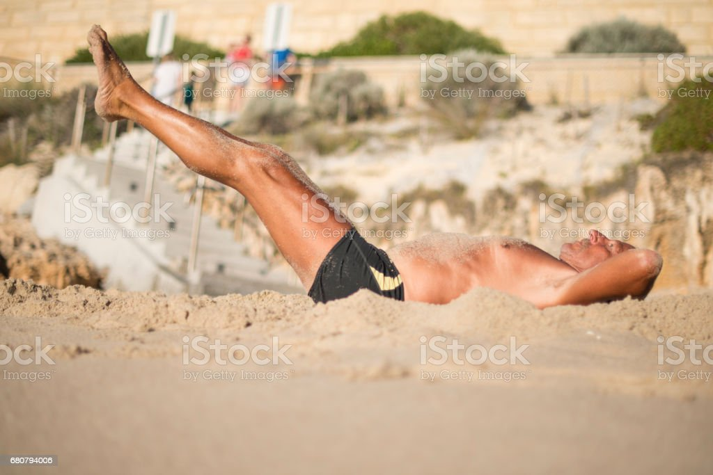 Senior man exercising at beach royalty-free stock photo