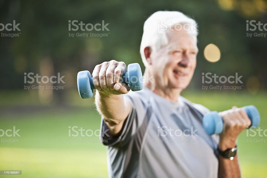 Senior man exercising outdoors stock photo