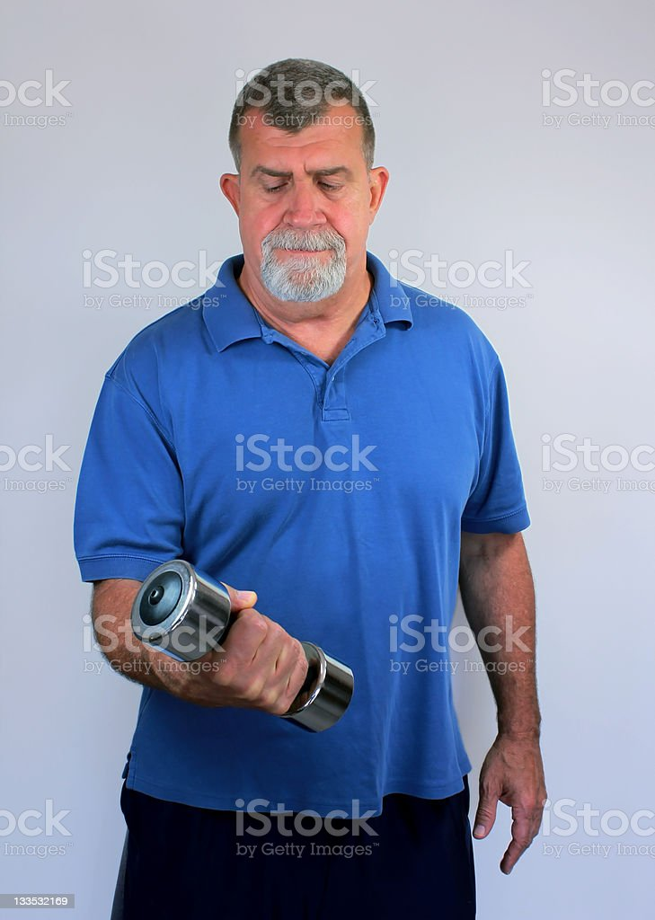 Senior Man Exercising with Dumbbell royalty-free stock photo