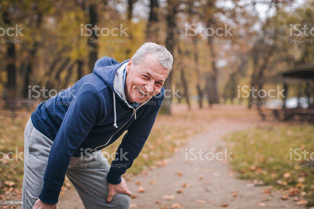 Senior man exercizing outdoors stock photo