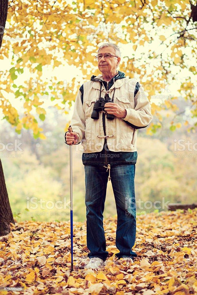 Senior man exploring nature stock photo