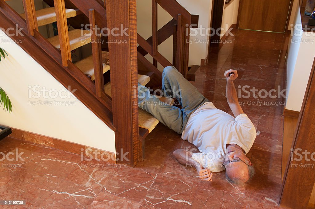Senior man fell down the stairs stock photo