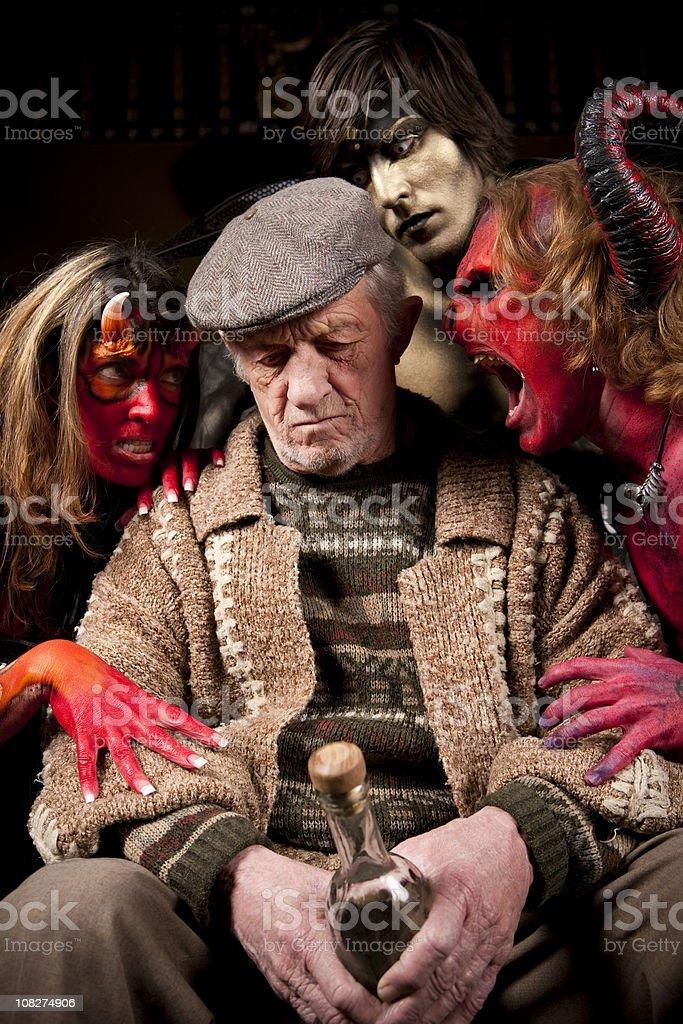 Senior Man Fighting the Temptation to Drink royalty-free stock photo