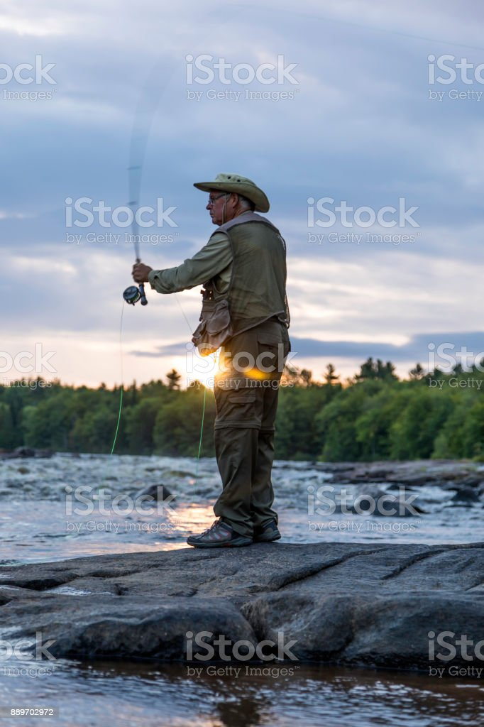 Senior Man Fisherman Fly Fishing in A River stock photo