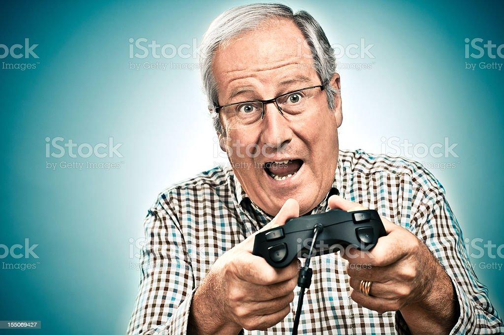 Senior man Game Playing royalty-free stock photo