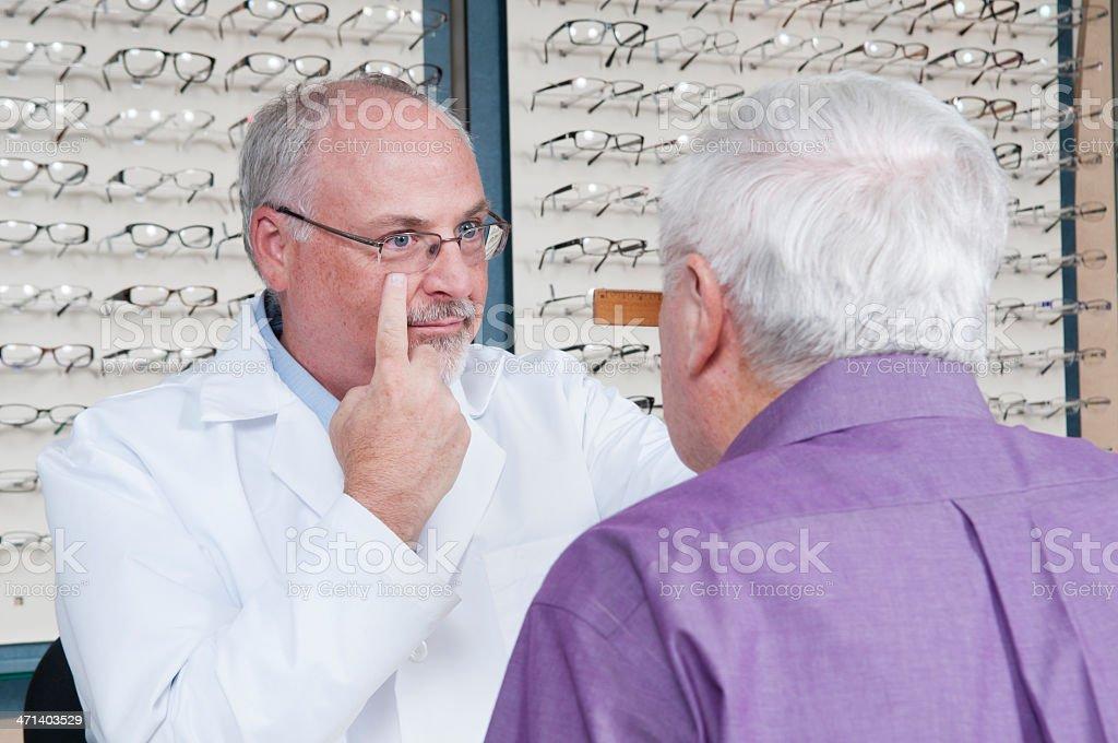 Senior Man Getting New Eyeglasses at Optometrist royalty-free stock photo