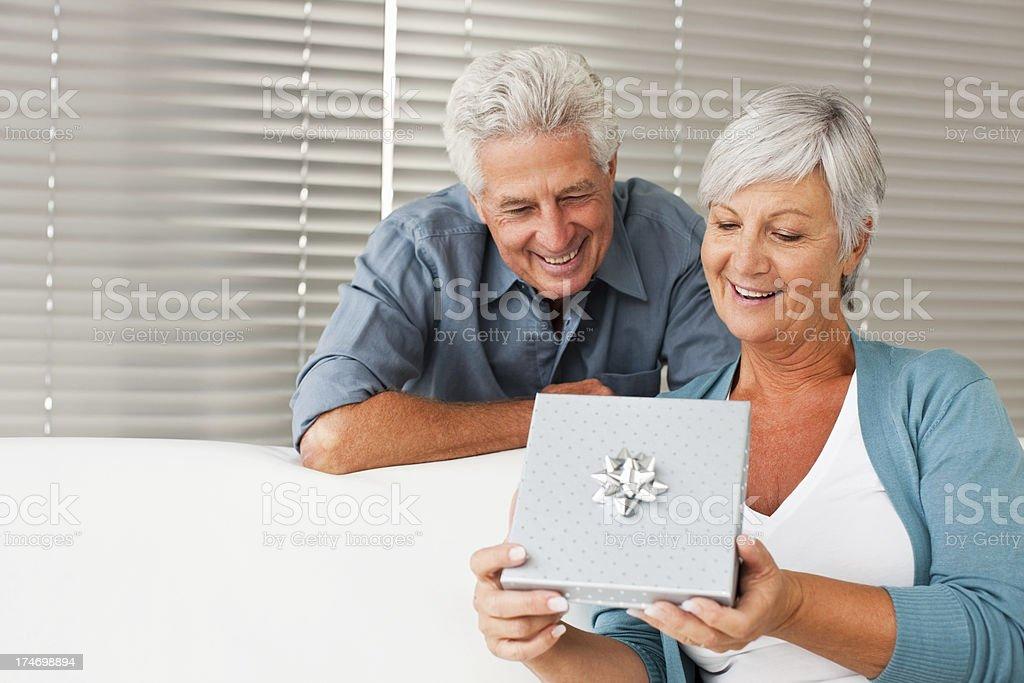 Senior man gifting loving wife royalty-free stock photo