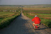 Senior Man Going for a Bicycle Ride on Tiny Bike