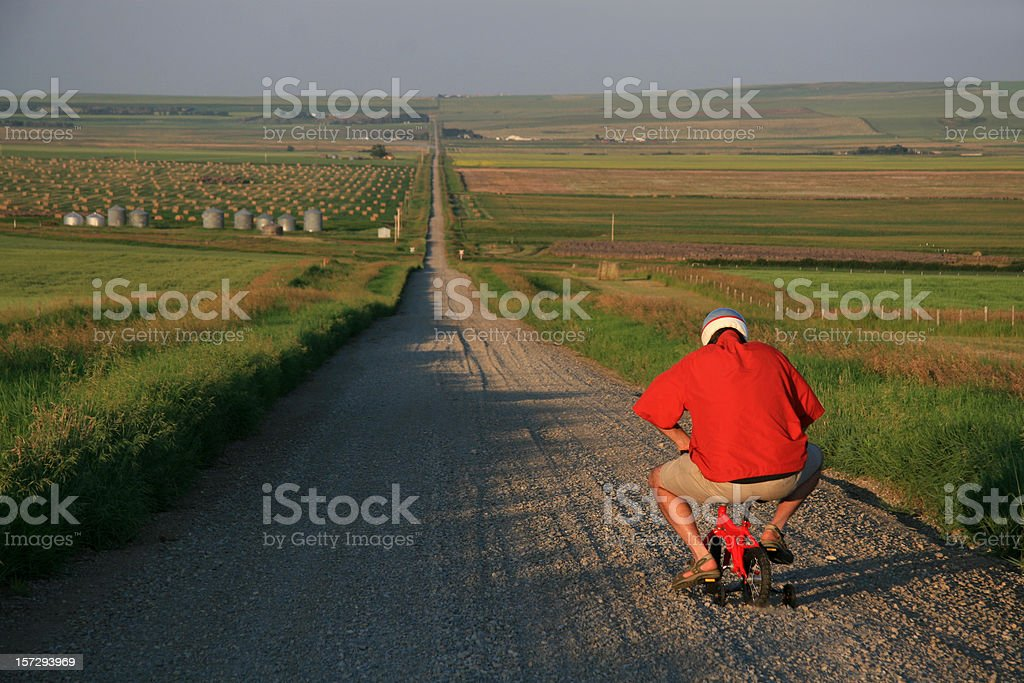 Senior Man Going for a Bicycle Ride on Tiny Bike stock photo